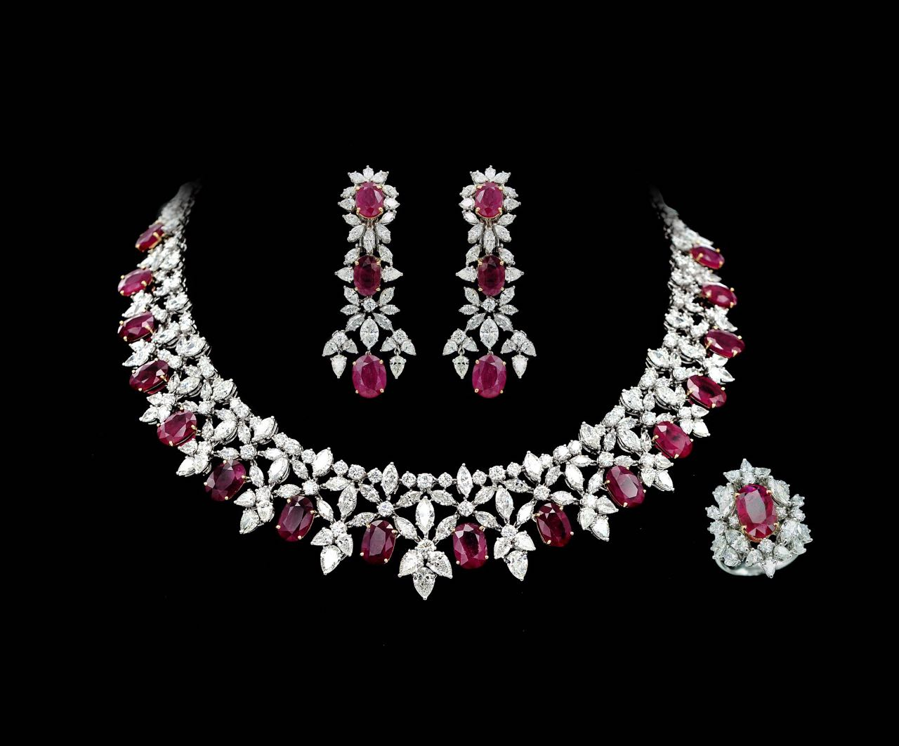 Diamond and ruby earring, necklace and ring set