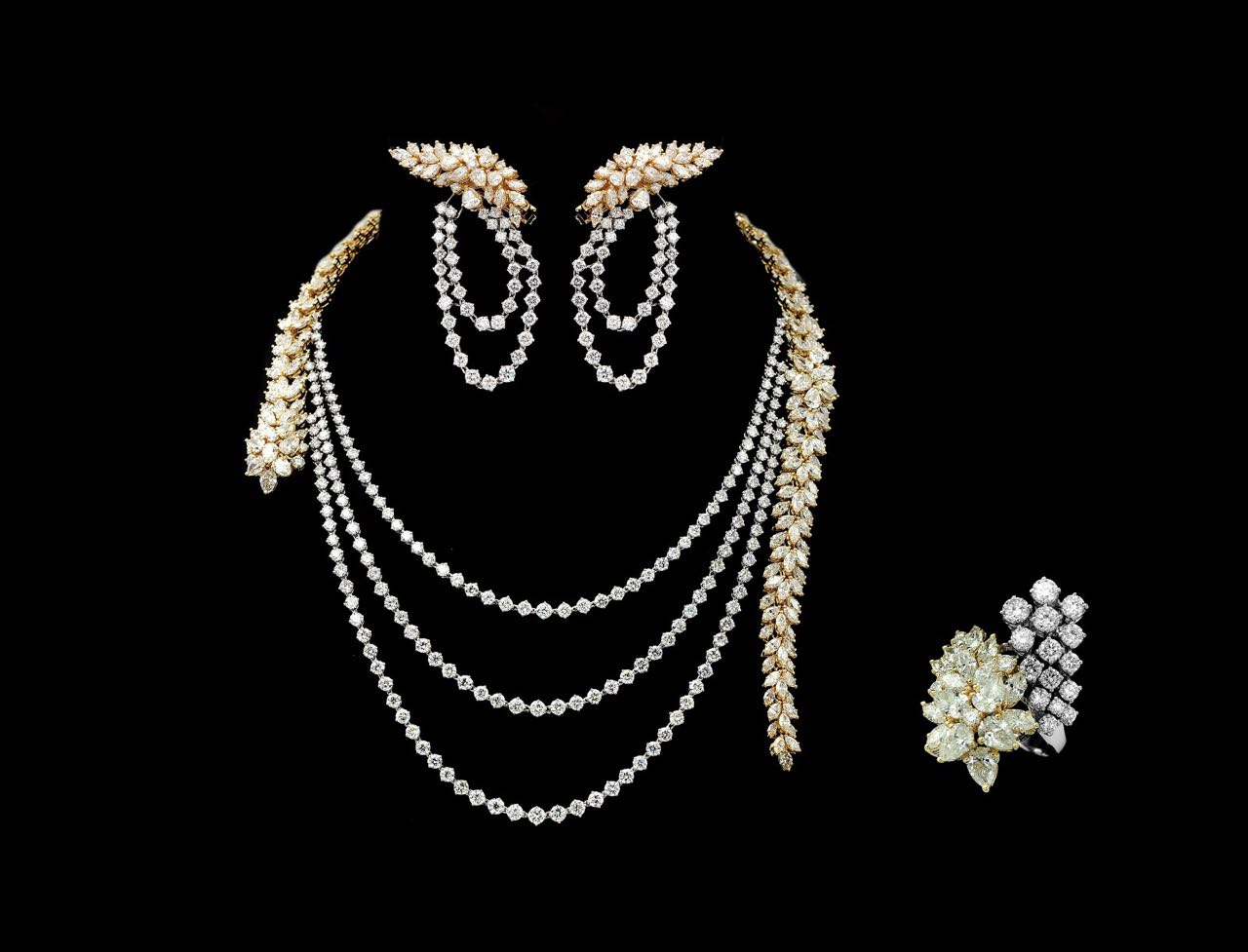 Contemporary diamond necklace, earrings and ring set