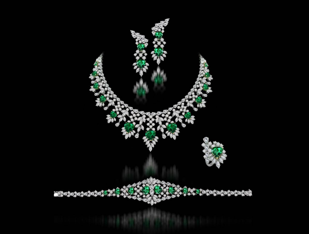 Diamond and emerald necklace, earrings, bracelet and ring set