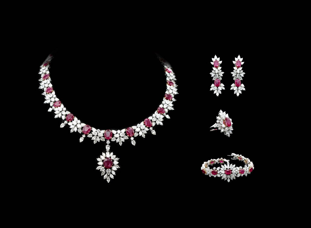 Diamond and ruby necklace, bracelet, earrings and ring set